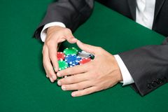 Poker player raking a big pile of poker chips Stock Photography