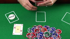 Poker player showes two aces and takes the pot. She won. Concept of gambling, risk, luck, win, fun, and entertainment stock video footage