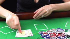 Poker player showes two aces and takes the pot. She won. Concept of gambling, risk, luck, win, fun, and entertainment. Poker player showes two aces and takes the stock footage