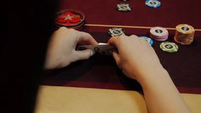Poker player showing good card combination, ace and king on poker table. Man`s hand close-up. Casino gamble. Poker player showing good card combination, ace and stock footage