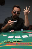 Poker player showing his dissatisfied face Stock Photos