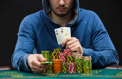 Poker player showing a pair of aces. Closeup Stock Image