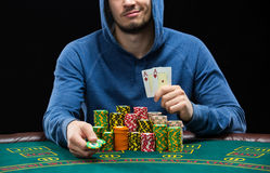 Poker player showing a pair of aces. Closeup Stock Photo