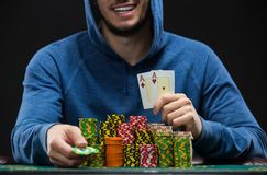 Poker player showing a pair of aces. Closeup Royalty Free Stock Images