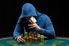 Poker player showing a pair of aces Stock Images