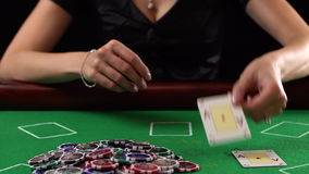 Poker player showing two aces and takes the pot. She won. Concept of gambling, risk, luck, win, fun, and entertainment. Poker player showing two aces and takes stock video
