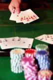 Poker player showing unbeatable royal flush Royalty Free Stock Image