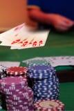 Poker player showing winning royal flush Royalty Free Stock Images