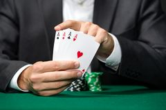 Poker player shows poker cards 4 aces Royalty Free Stock Photos