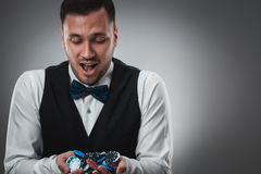 Poker player taking poker chips after winning Stock Photos