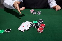 Poker player throwing down a pair of aces Royalty Free Stock Photo