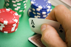 Poker player turning over hand. Poker player revealing an ace in his hand royalty free stock images