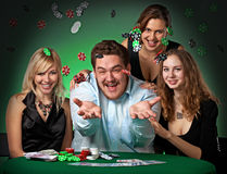 Poker players in casino with cards and chips Stock Images