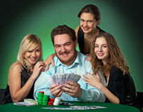 Poker players in casino with cards and chips Stock Photos