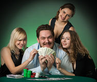 Poker players in casino with cards and chips Stock Photo