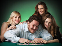 Poker players in casino with cards and chips Stock Photography