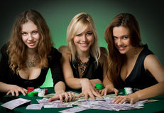 Poker players in casino with cards and chips Royalty Free Stock Images
