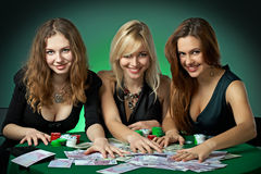 Poker players in casino with cards and chipsv Royalty Free Stock Images