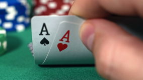Poker Players Checking Cards stock video footage
