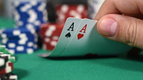 Poker Players Checking Cards. Holding Two Aces. Slow Motion Effect stock footage