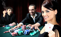 Poker players sitting around Royalty Free Stock Photos