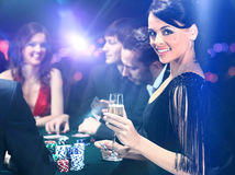 Poker players sitting in casino Royalty Free Stock Photo