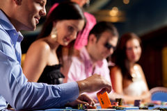 Poker players at the table Royalty Free Stock Photos