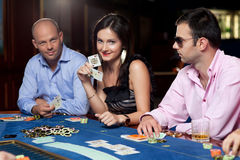 Poker players at table Stock Images