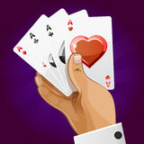 Poker playing card in hand Royalty Free Stock Image