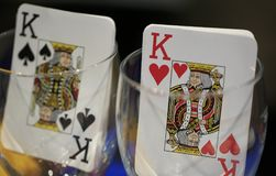 Poker playing card inside a glass cup.  Stock Photo