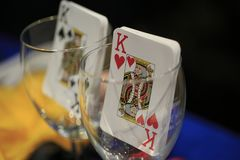 Poker playing card inside a glass cup.  Stock Photography