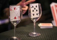 Poker playing card inside a glass cup.  Stock Image