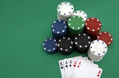 Poker playing cards. Four aces with chips on green background royalty free stock photography