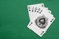 Poker playing cards. Royal flush on green background stock photography
