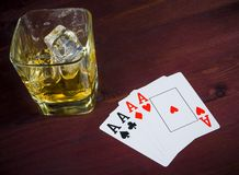 Poker playing cards near wiskey glass Royalty Free Stock Photography