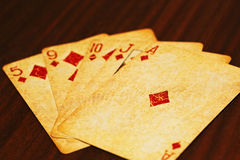 Poker playing cards on the table stock photography