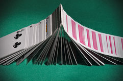 Poker playing cards turning face-up sequentially like dominoes Stock Images