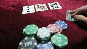 Poker playthe game of poker. the combination of two pairs. A pair of threes and tens. lie around the chips. the game is stock video