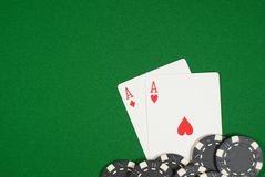 Poker, Pocket Aces. Poker Texas Hold`em, Pocket Aces; cards and chips on green cloth Stock Photos
