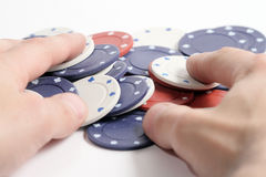 Poker raise. Raise all in poker game, chips all in, blue red and white hands pushing chips royalty free stock photography
