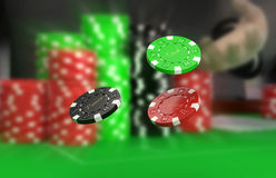 Poker raise. Close up to three flying fiche Royalty Free Stock Photos