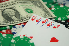 Poker Royal Flush. Different colored Poker Chips and Royal Flush (hearts) with Dollar bill Royalty Free Stock Photos