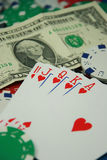 Poker Royal Flush. Different colored Poker Chips and Royal Flush (hearts) with Dollar bill Royalty Free Stock Images
