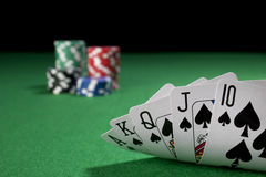 Poker, royal flush. The Royal Flush on a green poker table with gambling chip Stock Photography
