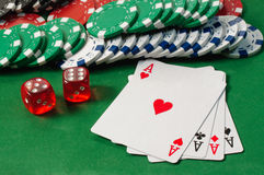 Poker, royal flush, dice and gambling chips Royalty Free Stock Photography