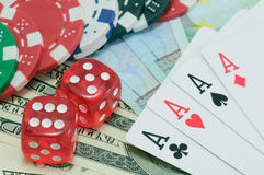Poker, royal flush, dice and gambling chips Royalty Free Stock Photo