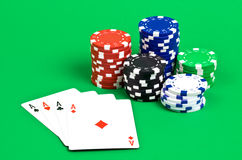 Poker scene. Poker aces with chips isolated on green background Stock Images