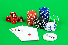 Poker scene. Poker aces with dice and chips Royalty Free Stock Photos
