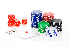 Poker scene. Poker aces with dice and chips isolated on white background Stock Images