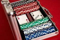 Poker set in metal suitcase. Risky entertainment of gambling. Top view on red background. Casino background. Copy space. Still life Stock Photography